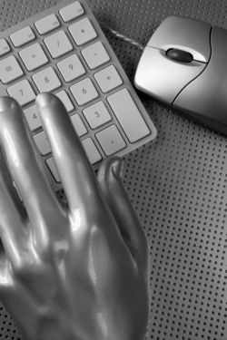 Hand on a computer keyboard
